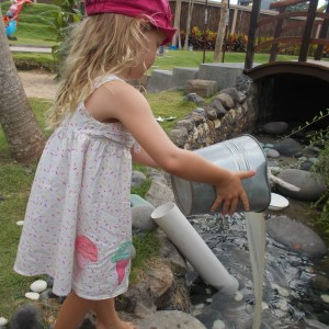 Preschool pouring water